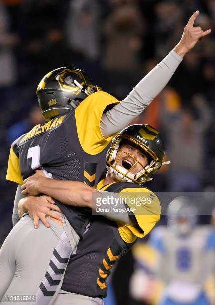 Sam Irwin-Hill of the San Diego Fleet lift kicker DonnyHageman after hekicked the winning field goal late in the fourth quarter of the Alliance of...