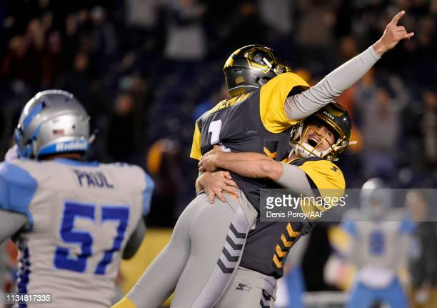 Sam IrwinHill of the San Diego Fleet lifts kicker Donny Hageman in celebration after Hageman kicked the winning field goal late in the fourth quarter...