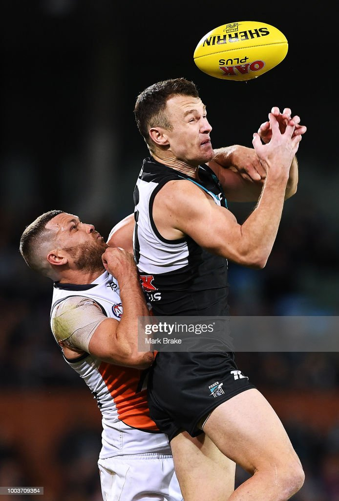 Sam J. Reid of the Giants spoils Brad Ebert of Port Adelaide during the round 18 AFL match between the Port Adelaide Power and the Greater Western Sydney Giants at Adelaide Oval on July 22, 2018 in Adelaide, Australia.
