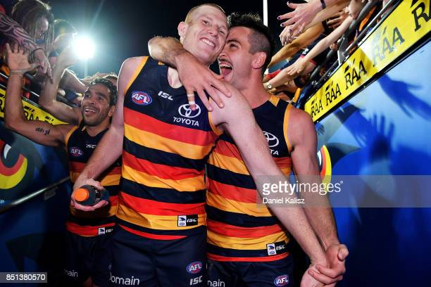 Sam Jacobs and Taylor Walker of the Crows celebrate after the First AFL Preliminary Final match between the Adelaide Crows and the Geelong Cats at...