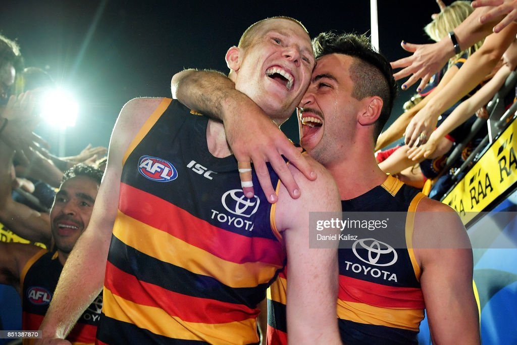Sam Jacobs and Taylor Walker of the Crows celebrate after the First AFL Preliminary Final match between the Adelaide Crows and the Geelong Cats at Adelaide Oval on September 22, 2017 in Adelaide, Australia.