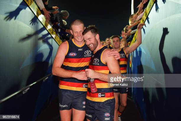 Sam Jacobs of the Crows and Andy Otten of the Crows walk from the ground atfer the round six AFL match between the Adelaide Crows and Gold Coast Suns...