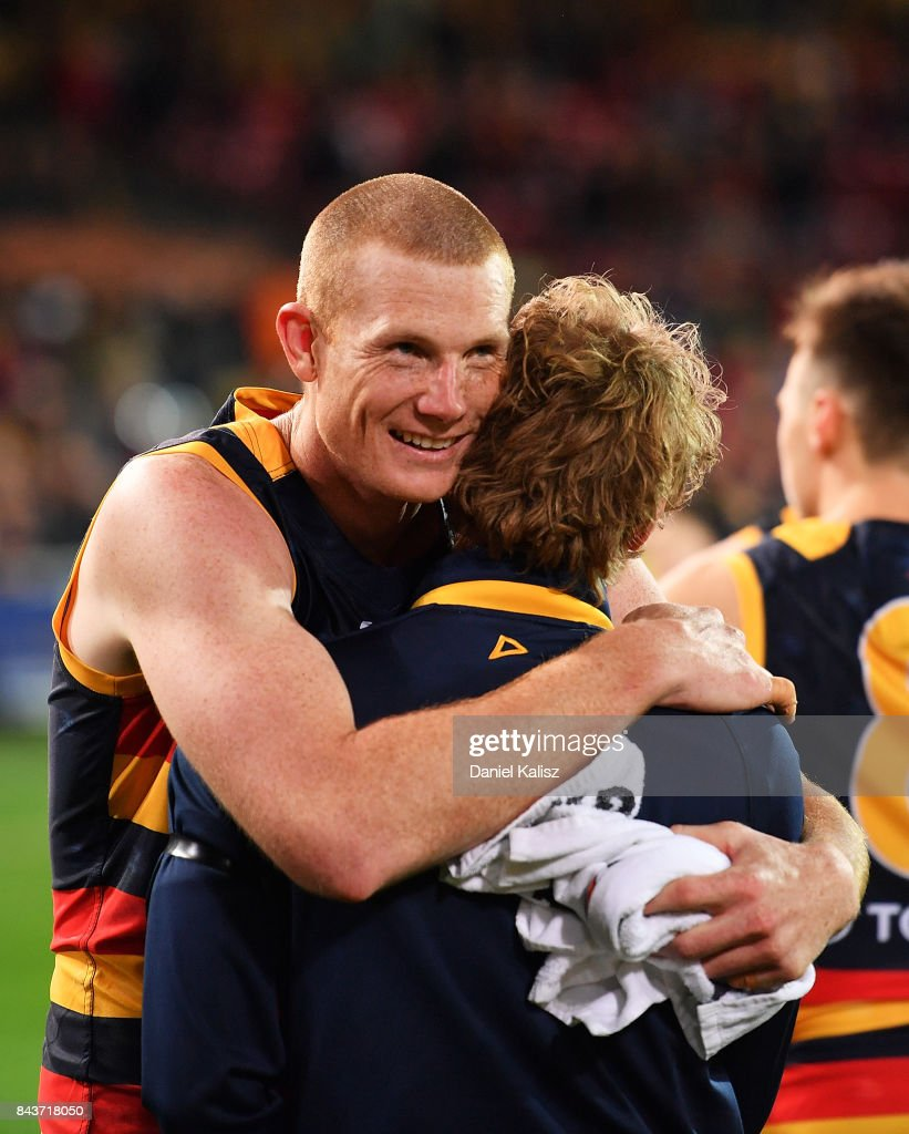 Sam Jacobs of the Crows and Rory Sloane of the Crows embrace after the AFL First Qualifying Final match between the Adelaide Crows and the Greater Western Sydney Giants at Adelaide Oval on September 7, 2017 in Adelaide, Australia.
