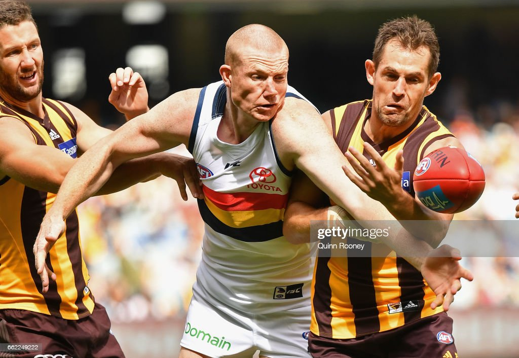 Sam Jacobs of the Crows is bumped by Luke Hodge of the Hawks during the round two AFL match between the Hawthorn Hawks and the Adelaide Crows at Melbourne Cricket Ground on April 1, 2017 in Melbourne, Australia.