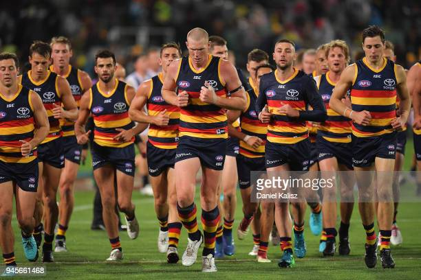 Sam Jacobs of the Crows runs from the field at half time during the round four AFL match between the Adelaide Crows and the Collingwood Magpies at...