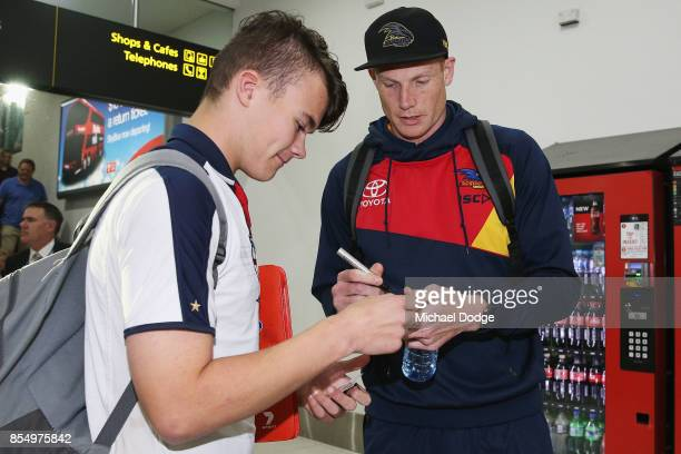 Sam Jacobs of the Crows signs autographs for fans on arrival at Melbourne Airport on September 28 2017 in Melbourne Australia Adelaide will play...