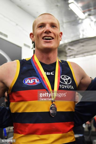 Sam Jacobs of the Crows sings the club song after the round 20 AFL match between the Adelaide Crows and the Port Adelaide Power at Adelaide Oval on...