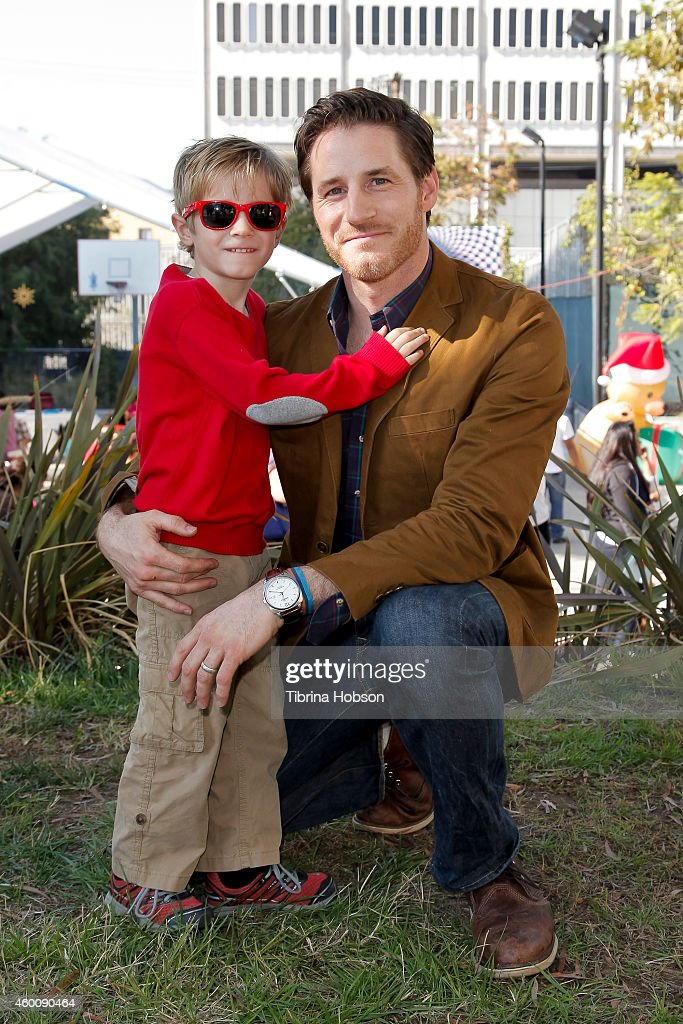 Sam Jaeger and his son Gus Jaeger attend the annual holiday
