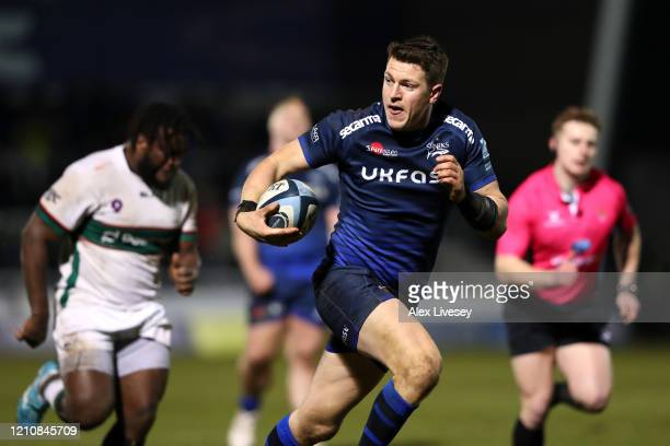 Sam James of Sale Sharks breaks through to score his second try during the Gallagher Premiership Rugby match between Sale Sharks and London Irish at...
