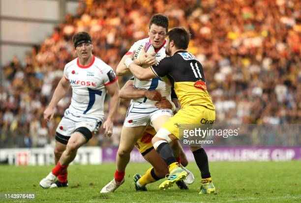 Sam James of Sale Sharks is tackled by Arthur Retiere of Stade Rochelais during the Challenge Cup Semi Final match between La Rochelle and Sale...
