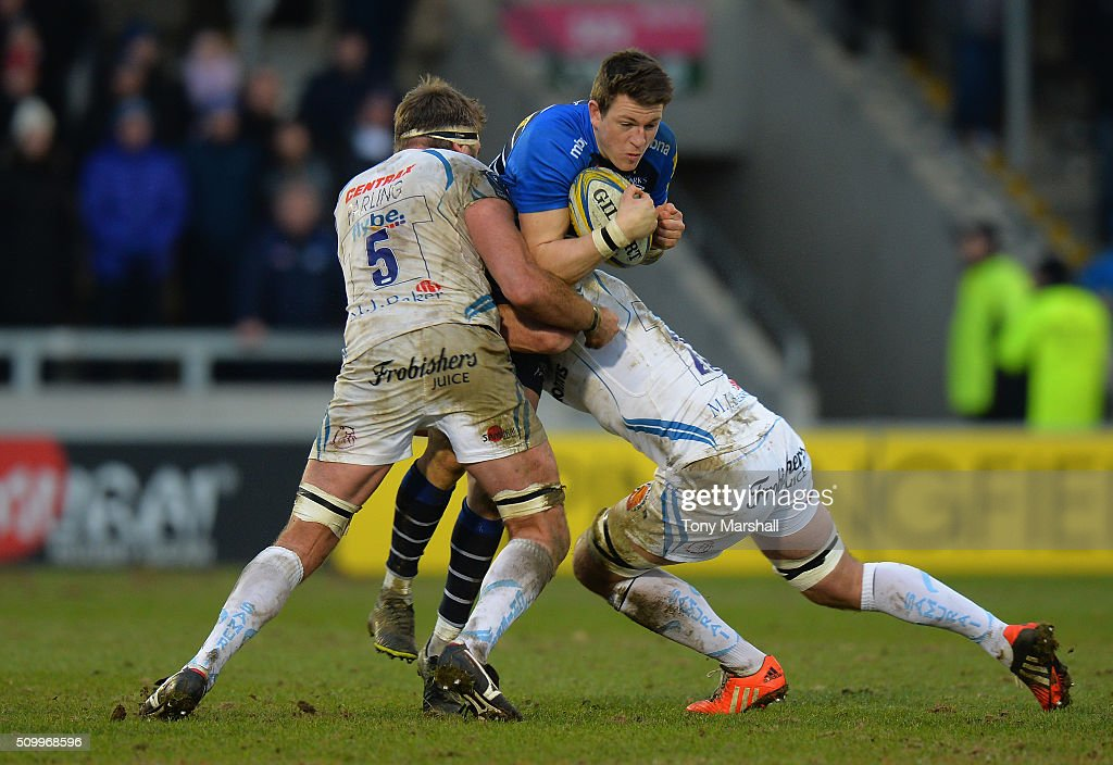 Sam James of Sale Sharks tackled by Geoff Parling and Kai Horstmann of Exeter Chiefs during the Aviva Premiership match between Sale Sharks and Exeter Chiefs at the A J Bell Stadium on February 13, 2016 in Salford, England