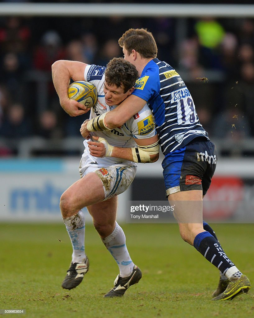 Sam James of Sale Sharks tackles Ian Whitten of Exeter Chiefs during the Aviva Premiership match between Sale Sharks and Exeter Chiefs at the A J Bell Stadium on February 13, 2016 in Salford, England