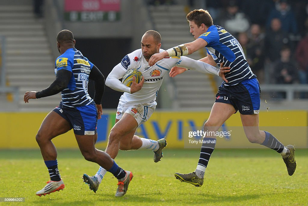 Sam James of Sale Sharks tackles Olly Woodburn of Exeter Chiefs during the Aviva Premiership match between Sale Sharks and Exeter Chiefs at the A J Bell Stadium on February 13, 2016 in Salford, England