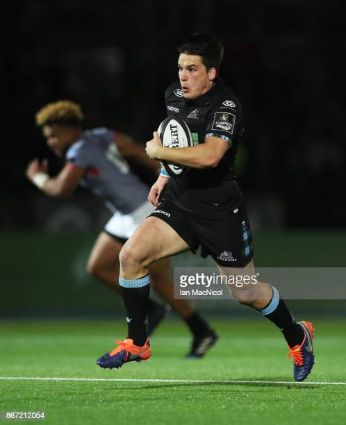 Sam Johnson of Glasgow Warriors runs with the ball during the Glasgow Warriors and Southern Kings Guinness Pro 14 match at Scotstoun Stadium on...