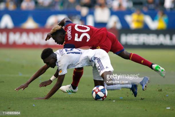 Sam Johnson of Real Salt Lake and Diedie Traore of Los Angeles Galaxy fall during a game at Dignity Health Sports Park on April 28 2019 in Carson...