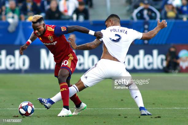 Sam Johnson of Real Salt Lake and Diego Polenta of Los Angeles Galaxy fight for control of the ball during the first half of a game at Dignity Health...