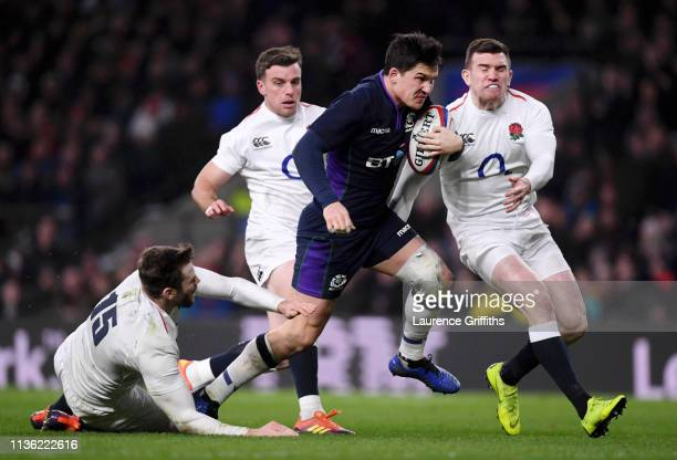 Sam Johnson of Scotland evades Elliot Daly George Ford and Ben Spencer of England as he crosses to score their sixth try during the Guinness Six...