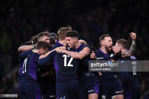Sam Johnson of Scotland is congratulated by Adam Hastings and Byron McGuigan after scoring the fifth try during the Guinness Six Nations match...