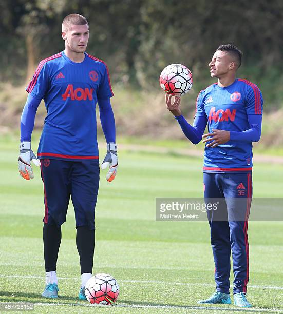Sam Johnstone and Jesse Lingard of Manchester United in action during a first team training session at Aon Training Complex on September 11 2015 in...