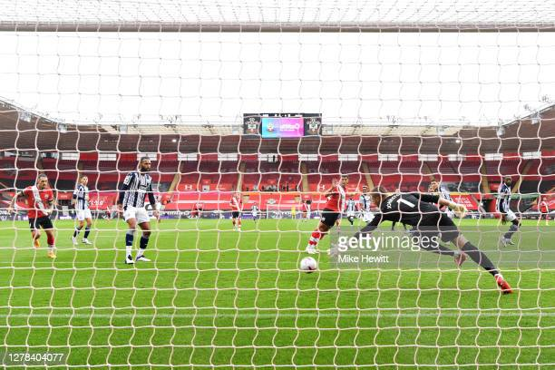 Sam Johnstone dives for the ball as Moussa Djenepo of Southampton scores his sides first goal during the Premier League match between Southampton and...