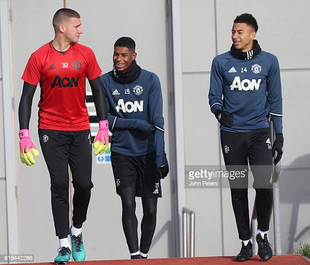 Sam Johnstone Marcus Rashford and Jesse Lingard of Manchester United in action during a first team training session at Aon Training Complex on...