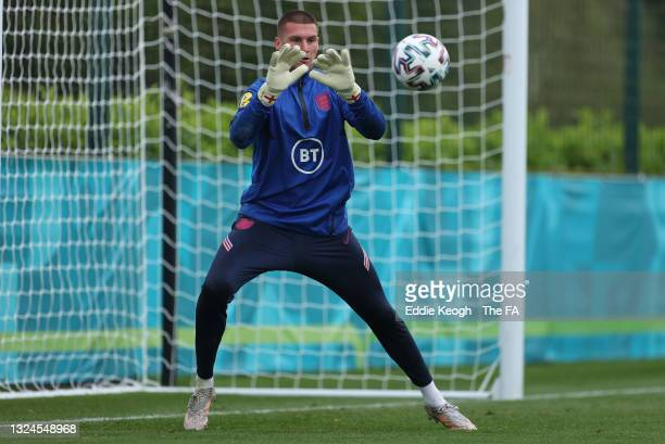Sam Johnstone of England makes a save during the England Training Session at Tottenham Hotspur Training Ground on June 20, 2021 in Burton upon Trent,...