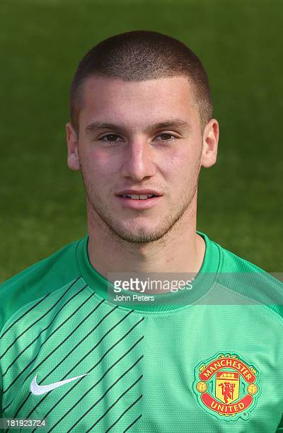 Sam Johnstone of Manchester United poses at the annual club photocall at Old Trafford on September 26 2013 in Manchester England