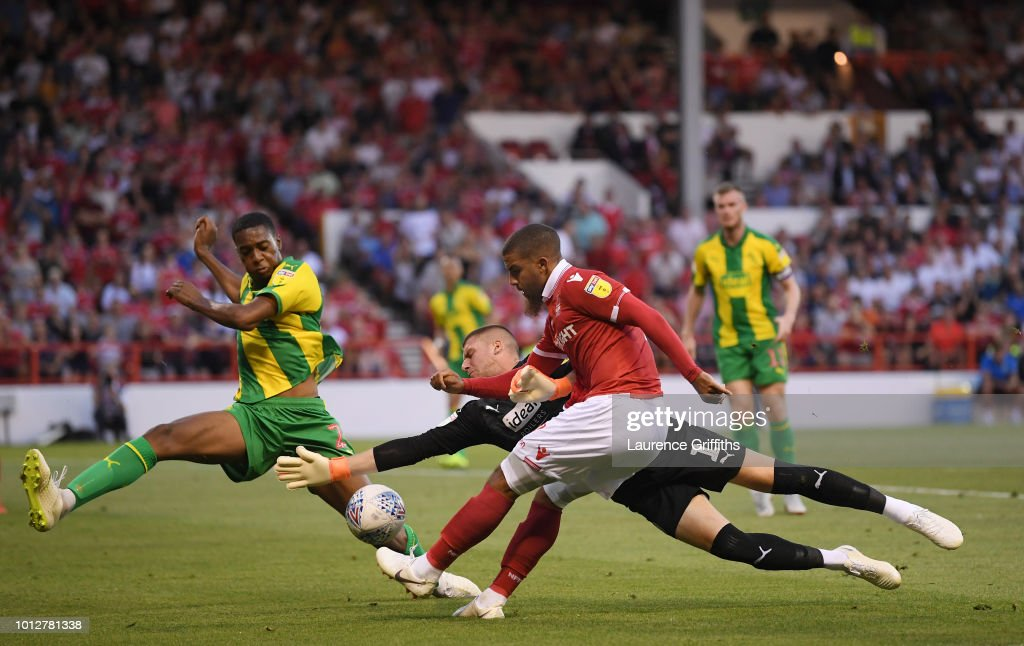 Sam Johnstone of West Bromwich Albion dives to save from Lewis Grabban of Nottingham Forest during the Sky Bet Championship match between Nottingham Forest and West Bromwich Albion at City Ground on August 7, 2018 in Nottingham, England.