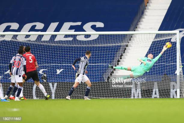 Sam Johnstone of West Bromwich Albion makes a save from the shot of Harry Maguire of Manchester United during the Premier League match between West...
