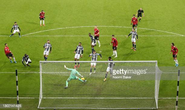 Sam Johnstone of West Bromwich Albion makes a save with his foot from Scott McTominay of Manchester United during the Premier League match between...