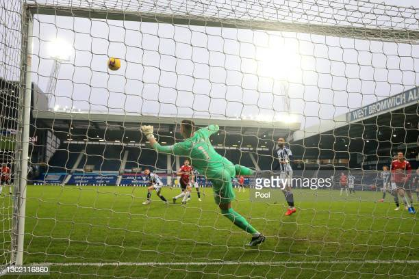 Sam Johnstone of West Bromwich Albion makes save from the shot of Harry Maguire of Manchester United during the Premier League match between West...