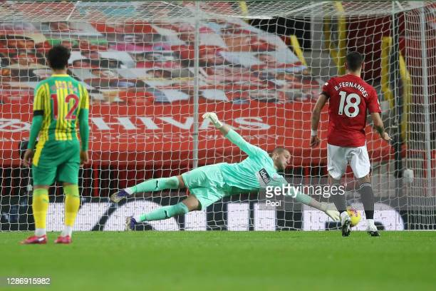 Sam Johnstone of West Bromwich Albion saves a penalty from Bruno Fernandes of Manchester United, which following a VAR is retaken, as Sam Johnstone...