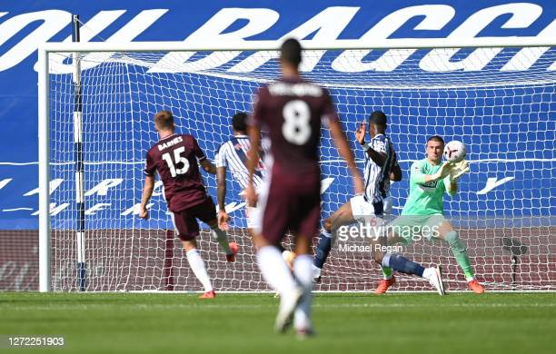 Sam Johnstone of West Bromwich Albion saves from Harvey Barnes of Leicester City during the Premier League match between West Bromwich Albion and...