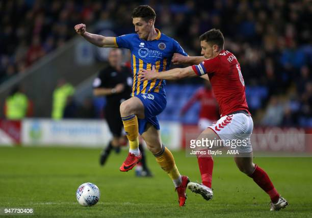 Sam Jones of Shrewsbury Town and Jason Pearce of Charlton Athletic during the Sky Bet League One match between Shrewsbury Town and Charlton Athletic...