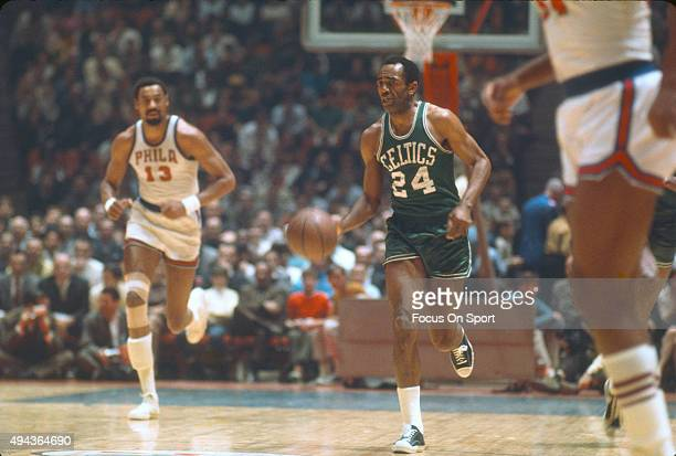 Sam Jones of the Boston Celtics dribbles the ball up court against the Philadelphia 76ers during an NBA basketball game circa 1965 at Convention Hall...