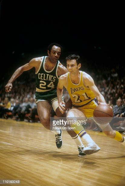 Sam Jones of the Boston Celtics tries to guard Johnny Egan of the Lost Angeles Lakers during an NBA basketball game circa 1968 at The Forum in...