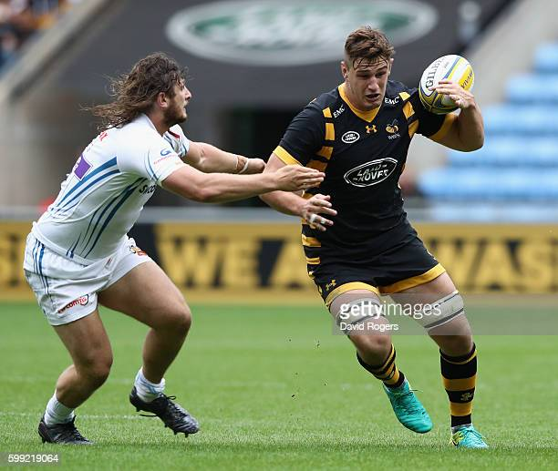 Sam Jones of Wasps is tackled by Alec Hepburn during the Aviva Premiership match between Wasps and Exeter Chiefs at the Ricoh Arena on September 4...