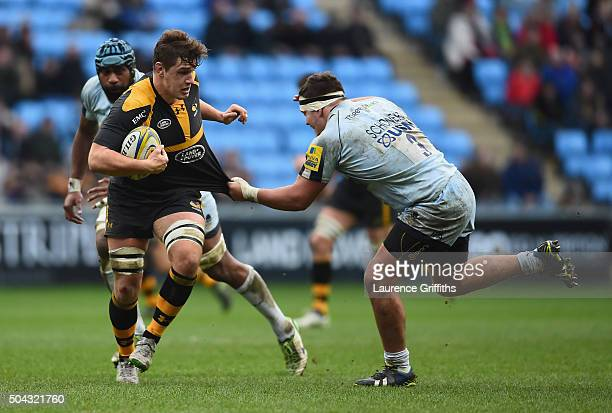 Sam Jones of Wasps is tackled by Mick Schonert of Worcester Warriors during the Aviva Premiership match between Wasps and Worcester Warriors at Ricoh...