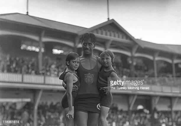Sam Kahanamoku the 'grandfather of surfing' with two young swimmers at a rock pool iin Sydney circa 1930s