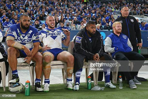 Sam Kasiano David Kremmer Frank Pritchard and James Graham of the Bulldogs watch on from the bench during the round 10 NRL match between the...
