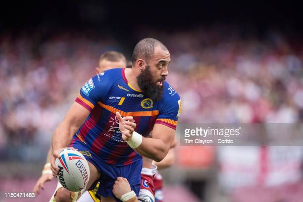 Sam Kasiano of Catalans Dragons sets up another try fro his side despite the defending on George Williams of Wigan Warriors during the Catalans...