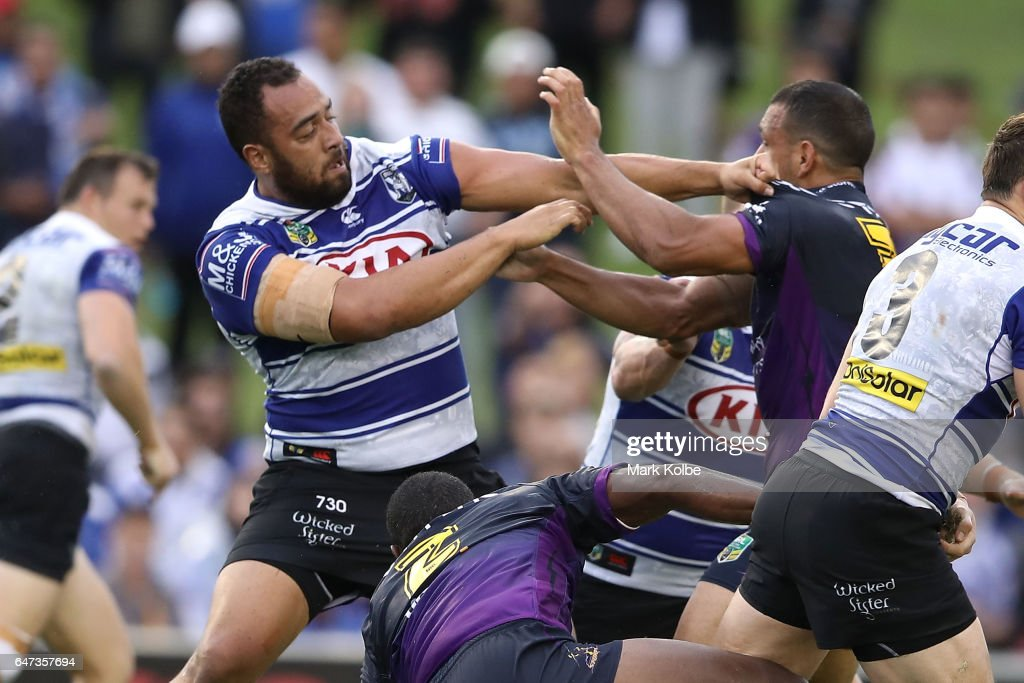 Sam Kasiano of the Bulldogs and Will Chambers of the Storm fight during the round one NRL match between the Canterbury Bulldogs and the Melbourne Storm at Belmore Sports Ground on March 3, 2017 in Sydney, Australia.