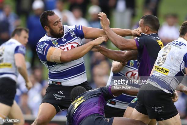 Sam Kasiano of the Bulldogs and Will Chambers of the Storm fight during the round one NRL match between the Canterbury Bulldogs and the Melbourne...