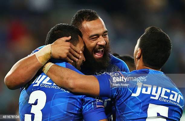 Sam Kasiano of the Bulldogs celebrates with team mate Krisnan Inu after Inu scored a try during the round 17 NRL match between the Canterbury...