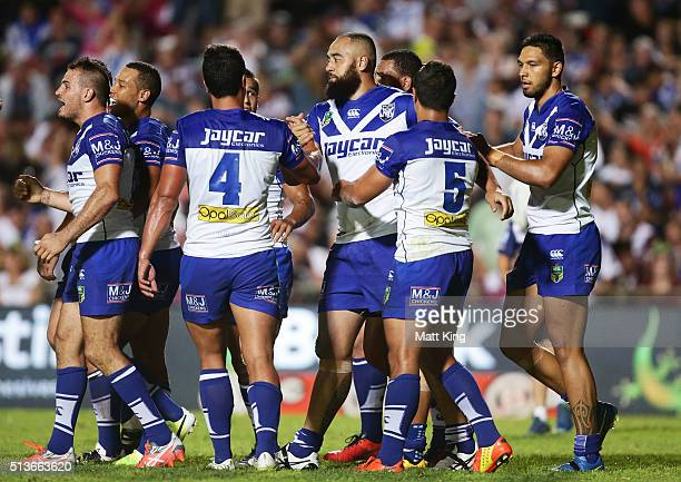 Sam Kasiano of the Bulldogs celebrates with team mates after scoring a try during the round one NRL match between the Manly Warringah Sea Eagles and...