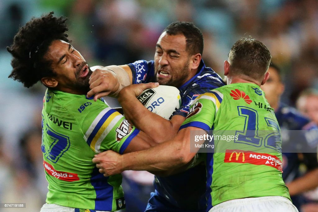 Sam Kasiano of the Bulldogs is tackled by Iosia Soliola of the Raiders (L) during the round nine NRL match between the Canterbury Bulldogs and the Canberra Raiders at ANZ Stadium on April 29, 2017 in Sydney, Australia.