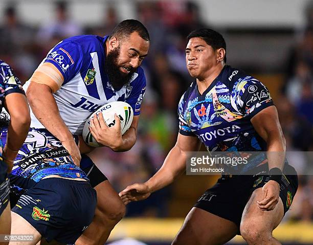 Sam Kasiano of the Bulldogs is tackled by Jason Taumalolo of the Cowboys during the round 20 NRL match between the North Queensland Cowboys and the...