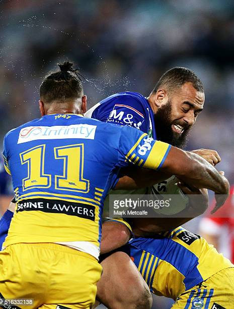 Sam Kasiano of the Bulldogs is tackled by Ken Edwards of the Eels during the round three NRL match between the Canterbury Bulldogs and the Parramatta...