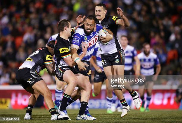 Sam Kasiano of the Bulldogs is tackled during the round 21 NRL match between the Penrith Panthers and the Canterbury Bulldogs at Pepper Stadium on...