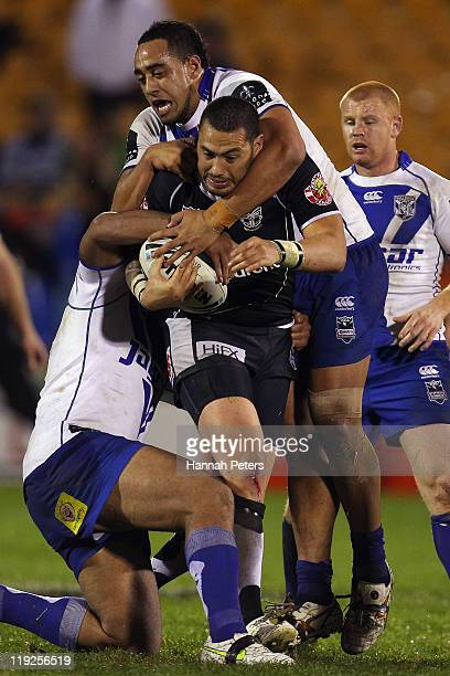 Sam Kasiano of the Bulldogs tackles Feleti Mateo of the Warriors during the round 19 NRL match between the Warriors and the Canterbury Bulldogs at Mt...